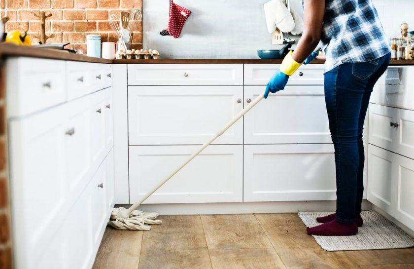 man sweeping the floor