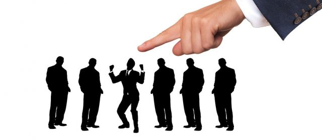finger pointing to someone being hired