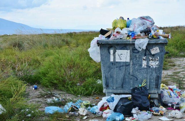 pile of rubbish in a trash bin